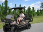 Teena Dobbs Newman driving her Stealth Predator, with cat Scooter, on her south GA pine tree farm.